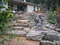 waterfall stone stairs feature patio