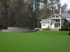 lawn with stone wall